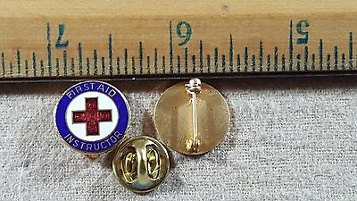 1928 First Aid Instructor pin.  National American Red Cross