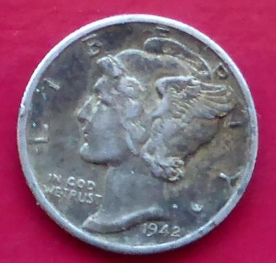 A 1942 D Silver Mercury One Dime Coin From The United States Of America.