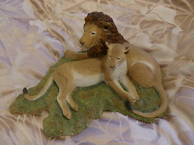Sherratt & Simpson-Lion And Lioness laying down on the grass 55405