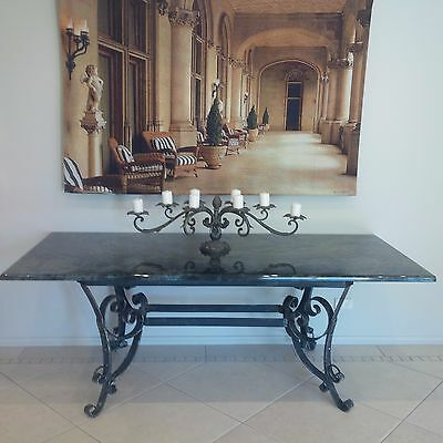 Granite table with wroght iron base indoor / outdoor