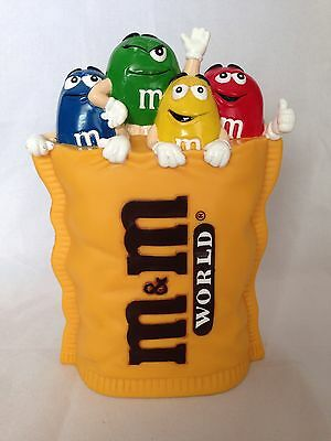 M&M YELLOW COIN BANK WITH CHARACTERS M & M World