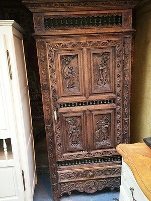 Carved antique oak cupboard