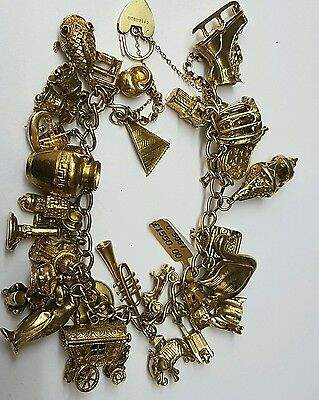 heavy 9ct gold charm bracelet