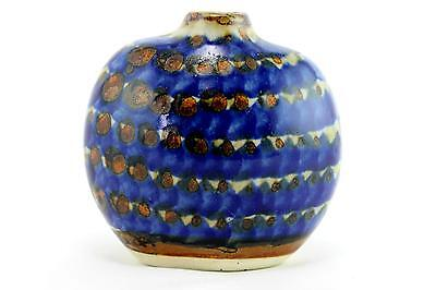 A handpainted blue striped Mexican pottery vase