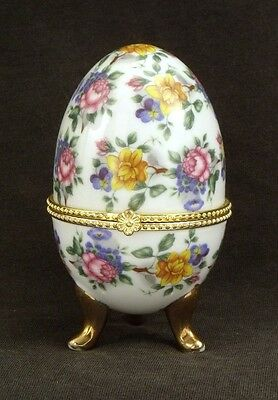 Porcelain hinged egg shaped trinket box with a pattern of pink and yellow roses