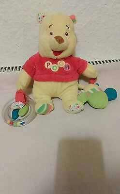 Winnie the Pooh with rattle adorable Teddy Bear soft toy by Disney baby.