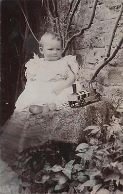 Unknown Baby With Toy Railway Engine Real Photo