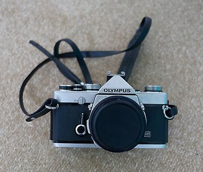 Olympus OM1 SLR film camera and two lenses