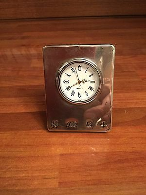 Silver Small Travel Clock by GK and CK. With Other Stamps