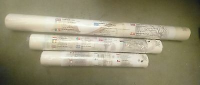 3 rolls of pre-primed canvas different sizes