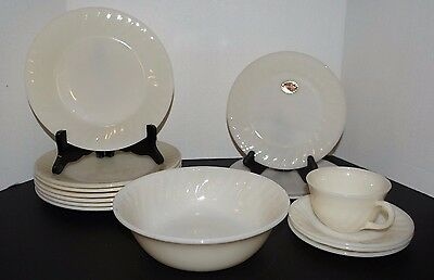13 Pieces of Ivory Fire King Swirl Dinnerware some with Foil Labels     (H3)