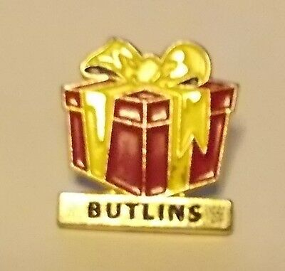 Enamel Badge - Butlins ( Wrapped Present ? )  with butterfly clip