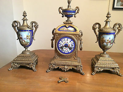French Mantel Clock With Sevres Panel and Sevres Porcelain Garnitures