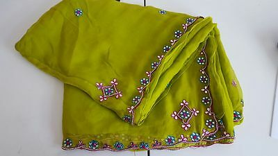 lime/olive saree with blue, red mirror and bead embroidery.blouse included