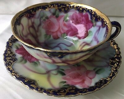 Nippon Unmarked Roses And Ribbons Tea Cup & Saucer