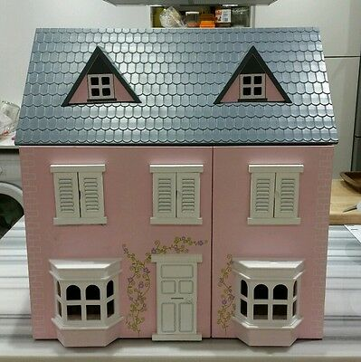 Dolls House in good condition wooden