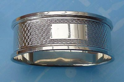 A 1971 HALLMARKED STERLING SILVER NAPKIN RING  Wt.10.6gms. by Broadway & Co.