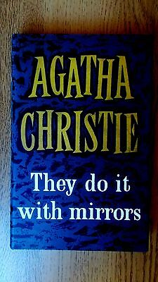 They do it with mirrors by Agatha Christie. Facsimile of 1st edition. Fine.