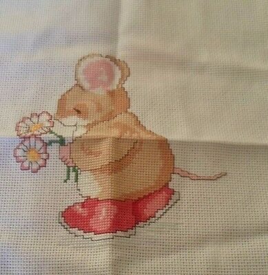 Completed cross stitch mouse with flowers