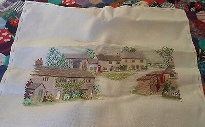 Completed cross stitch cottages