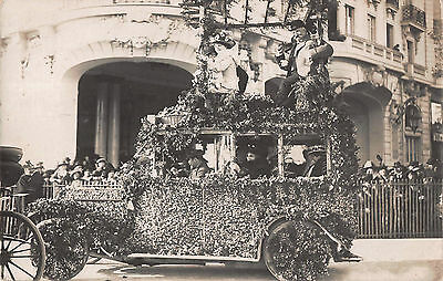 c1910s RP ~ PEOPLE RIDE ATOP FLORAL DECORATED MOTOR CAR ~ PARADE/CARNIVAL FLOAT
