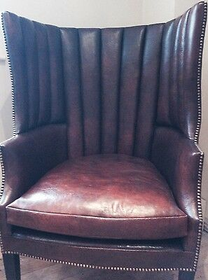 Antique Leather barrel back wing armchair