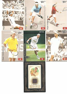 7 Different Roger Federer cards including Rookie cards and a match worn Jersey.