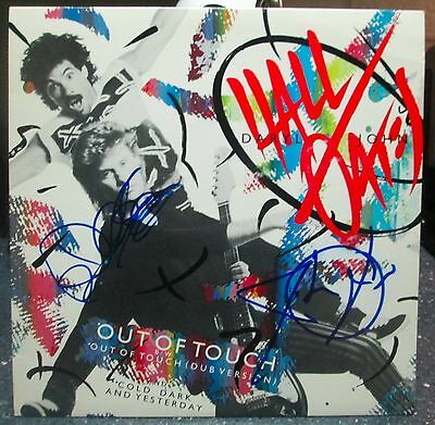 """Hall & Oates signed Out of Touch 12"""" lp"""