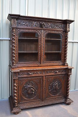large heavy carved oak bookcase