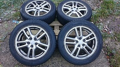 Full set of Subaru alloy wheels with good winter tyres