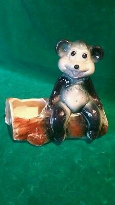 Old American Bisque Bear setting on a log planter Cute         BEST OFFER