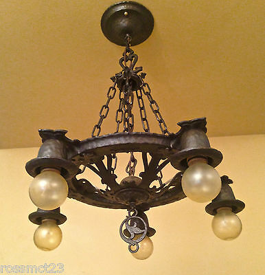 Vintage Lighting 1930s Spanish Revival Dog Head chandelier by Virden