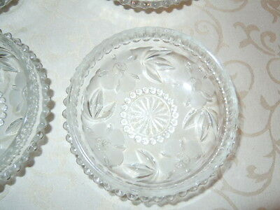 Beautiful vintage glass fruit dessert dishes with etched flower design