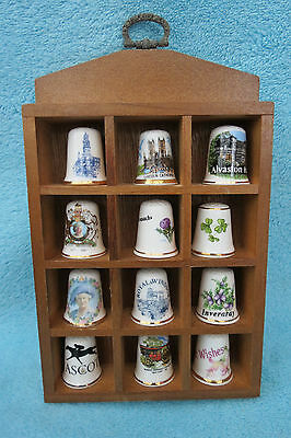 Collection Of 12 Porcelain Thimbles In A Display Rack.