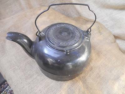 Old Wrought Iron Range Co. Cast Iron Tea Kettle With Stove Advertising