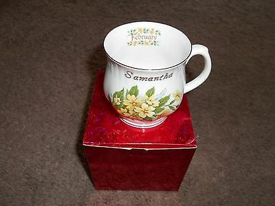 Bone china mug with Samantha February in gold and floral pattern
