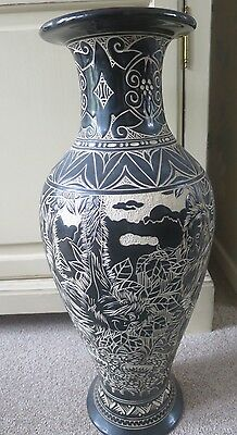 Tall Malaysian style engraved vase