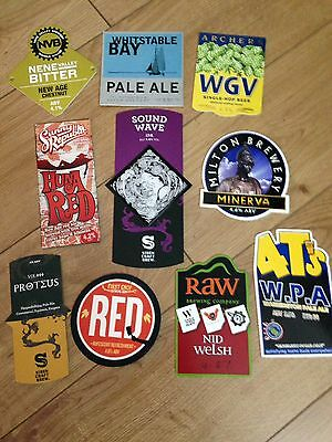 Collection Of 10 Pump Clip Badges.
