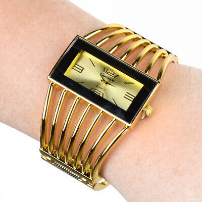 Luxury Women's Golden Bangle Bracelet Analog Wrist Watch Hollow Alloy Band