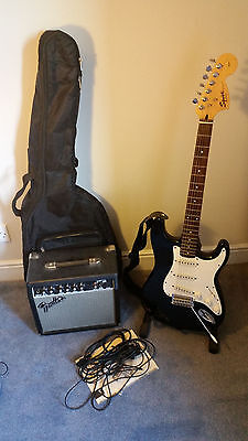 Black Squier Stratocaster by Fender Electric Guitar & Fender Frontman 15G Amp