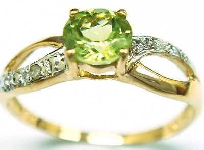 Peridot and Diamond ladies, 9CT Gold Ring, real, authentic. new.size O