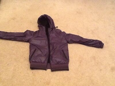 Reversible jacket, size XS. Eastpak, purple and black. Take a look.
