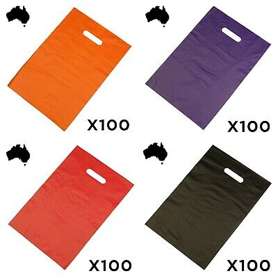 100 X PLASTIC CARRY BAGS Medium Size Bag With Die Cut Handles YOU CHOOSE COLOUR