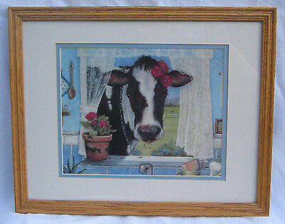 Country Setting Of A Cow Looking In Window Of Kitchen In Wooden Frame.