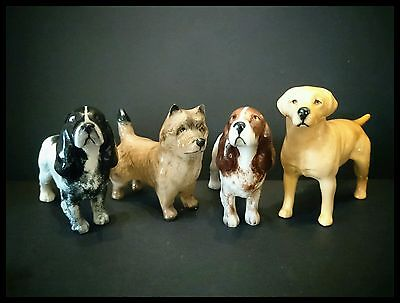 4 Beswick Dogs Spaniel, Retriever And Cairn Terrier