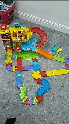 Vtech Toot toot garage, extra track and 3 cars