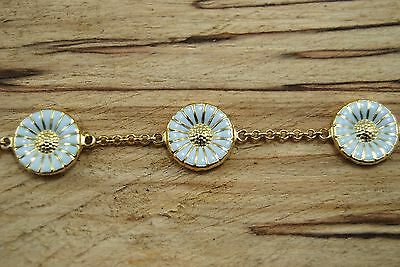 Georg Jensen bracelet in gilded sterling silver with 5 double sided daisys