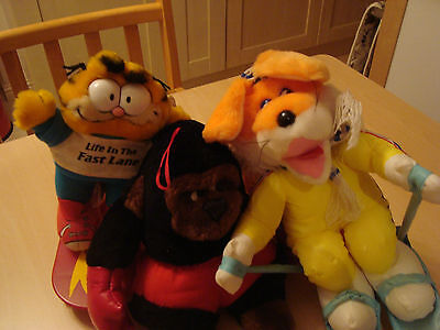Garfield on a skateboard and 2 soft toys.