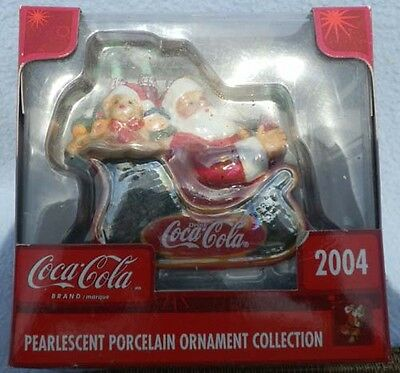 Coca-Cola Pearlescent Porcelain Ornament Collection ~ 2004 Dated Santa In A Sled