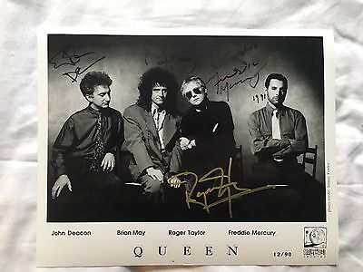 Queen Signed Press Photo Freddie Mercury 1991 Brian May John Deacon Autograph